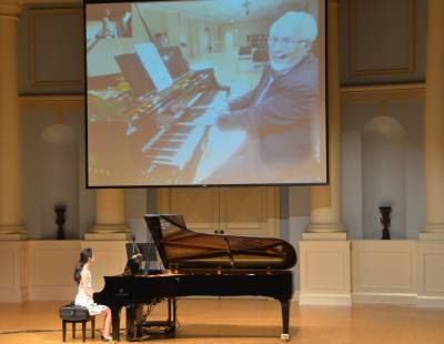 Juilliard Professor Julian Martin instructs a young pianist in Birminham from New York City